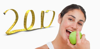 3D Composite image of close up a brunette eating a green apple Royalty Free Stock Photos