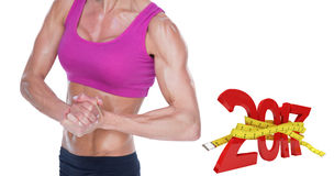 3D Composite image of female bodybuilder flexing in sports bra and shorts stock photos