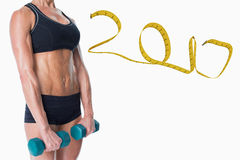 3D Composite image of female bodybuilder holding two dumbbells with arms down royalty free stock images