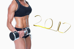 3D Composite image of female bodybuilder working out with large dumbbells mid section stock photo