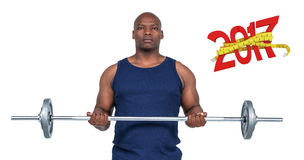 3D Composite image of fit man lifting heavy barbell. Fit man lifting heavy barbell against digital image of 3D new year with tape measure Royalty Free Stock Photography