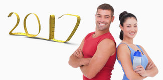 3D Composite image of fit man and woman smiling at camera together. Fit men and women smiling at camera together against white background with vignette 3D new stock images