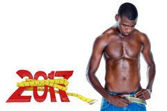 3D Composite image of fit shirtless young man. Fit shirtless young man against digitally generated image of 3D new year with tape measure Stock Photos