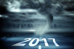 3D Composite image of happy new year 2017. Happy New Year 2017 against 3D  stormy sky with tornado over road Royalty Free Stock Images
