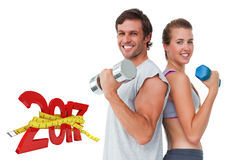 3D Composite image of portrait of a fit couple exercising with dumbbell royalty free stock images