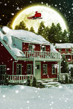 3D Composite image of snow covered house. 3D Snow covered house against composite image of forest on snowy field Royalty Free Stock Photo
