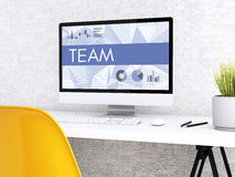 3d Computer with word TEAM. 3D illustration. Modern workspace and computer with word TEAM. Technology and business concept Royalty Free Stock Photography