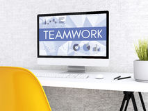 3d Computer with words TEAM WORK. 3D illustration. Modern workspace and computer with words TEAM WORK. Technology and business concept Stock Photo
