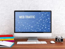3d Computer with words WEB TRAFFIC. 3D illustration. Modern workspace and computer with words WEB TRAFFIC. Technology and Network concept Royalty Free Stock Images