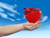 3D conceptual heart with a ribbon held in hands Stock Photography