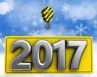 3d crane hook with metal 2017 sign. 3d illustration of metal 2017 sign with crane hook over snow background Royalty Free Stock Image