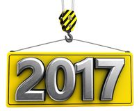 3d crane hook with metal 2017 sign. 3d illustration of metal 2017 sign with crane hook over white background Royalty Free Stock Images