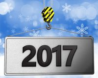 3d crane hook with 2017 sign. 3d illustration of 2017 sign with crane hook over snow background Stock Photos