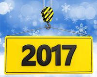 3d crane hook with 2017 sign. 3d illustration of 2017 sign with crane hook over snow background Stock Image