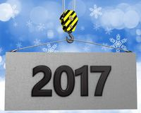 3d crane hook with 2017 sign. 3d illustration of 2017 sign with crane hook over snow background Royalty Free Stock Photography