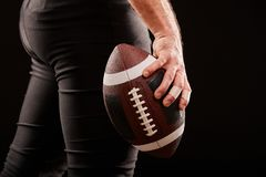 American football player holding ball against gloomy sky royalty free stock image