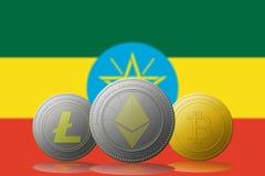 3D cryptocurrencies Bitcoin Ethereum et Litecoin de l'illustration trois avec le drapeau de l'Ethiopie sur le fond Images stock