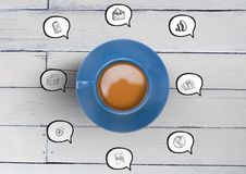 3D Cup with speech bubble icon drawings against wood. Digital composite of 3D Cup with speech bubble icon drawings against wood Royalty Free Stock Image