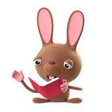 3d Cute Easter bunny rabbit is reading a book Royalty Free Stock Image