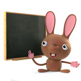 3d Cute Easter bunny rabbit stands at the blackboard Royalty Free Stock Photo