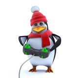 3d Cute winter penguin is playing a video game Royalty Free Stock Photography