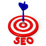 3D dartboard concept - `SEO`. 3D red and white dartboard and blue arrow - `SEO` search engine optimization word Stock Photo