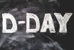 D-day written on black chalkboard Stock Photos