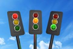 3d de los semáforos rojos, amarillos y verdes rinden imágenes de archivo libres de regalías