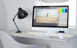 3d desktop workspace rendering photo edit software. 3d rendering of a desktop workplace with computer photo software. All screen graphics are made up Stock Images