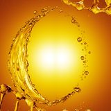 3D detailed illustration of a drop of water gold color. Yellow background Stock Photography