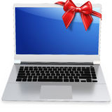 3d detailed laptop with red bow. On white background Stock Photography