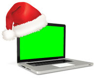 3d detailed laptop with santa's hat Royalty Free Stock Photography