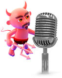 3d Devil with a retro microphone Royalty Free Stock Photos