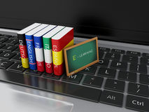 3d Dictionaries and blackboard on computer keyboard. E-learning Stock Photos
