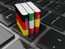 3d Dictionaries on computer keyboard. E-learning. 3d illustration. Dictionaries on computer keyboard. E-learning. Languages learn and translate, education Royalty Free Stock Photo