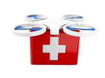 3D Drone carrying a first aid kit. 3d renderer image. Drone carrying a first aid kit. Delivery concept.  white background Royalty Free Stock Photos