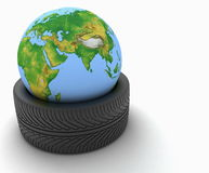 3d earth globe in a car tire on white. Background Royalty Free Stock Photo