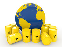 3d earth globe and radiation symbol barrels Stock Images