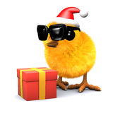 3d Easter chick celebrates Christmas with a gift Stock Image
