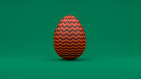 3D Easter Egg with red pattern on green background Royalty Free Stock Photos