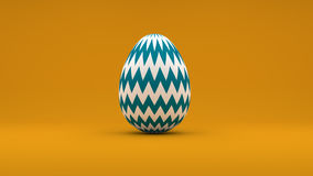 3D Easter Egg with white and blue stripes on orange background.  Royalty Free Stock Image
