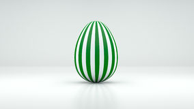 3D Easter Egg with white and green stripes on grey background Royalty Free Stock Photos