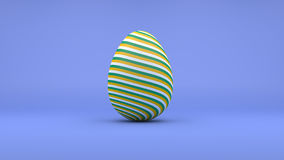 3D Easter Egg with white, yellow and green stripes on blue backg Royalty Free Stock Images