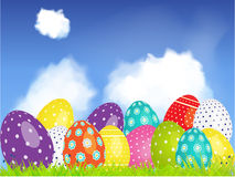 3D Easter eggs selection on a blue sky and clouds Stock Images