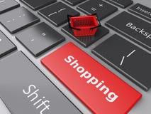 3d Einkaufskorb auf Computertastatur auf weißem background Lizenzfreie Stockfotos