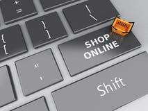 3d Einkaufskorb auf Computertastatur auf weißem background Lizenzfreies Stockbild