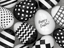 3d elegant Easter eggs with black and white patterns. 3d Easter eggs with black and white patterns lying on wooden desk Royalty Free Stock Photo