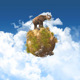 3D elephant on a grass and rock globe Stock Image