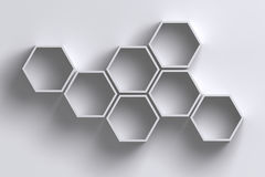 3D empty honeycomb hexagon shelves on white wall with shadow Stock Images