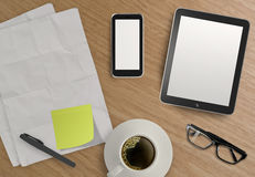 3d empty tablet and a cup of coffee with note pad. On the wooden desk Royalty Free Stock Photo